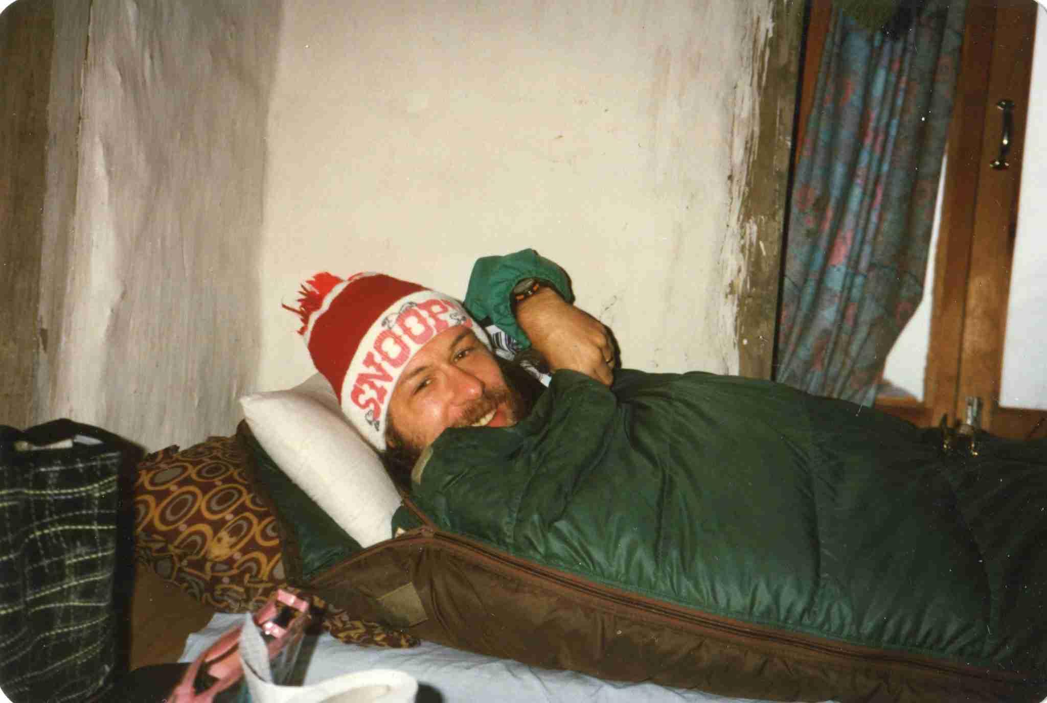 John with cap in sleeping bag