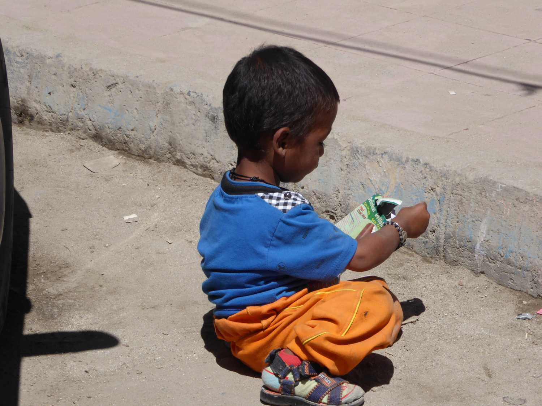 Kid playing on street