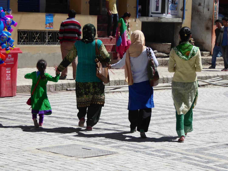 Colorful ladies strolling