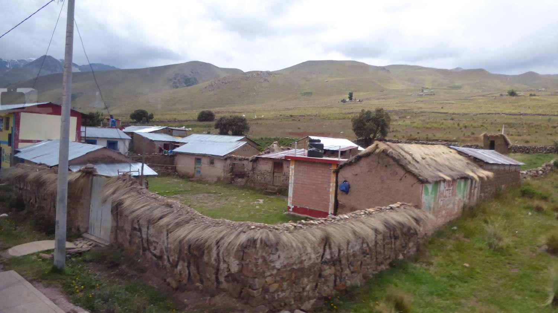a few houses behind a wall