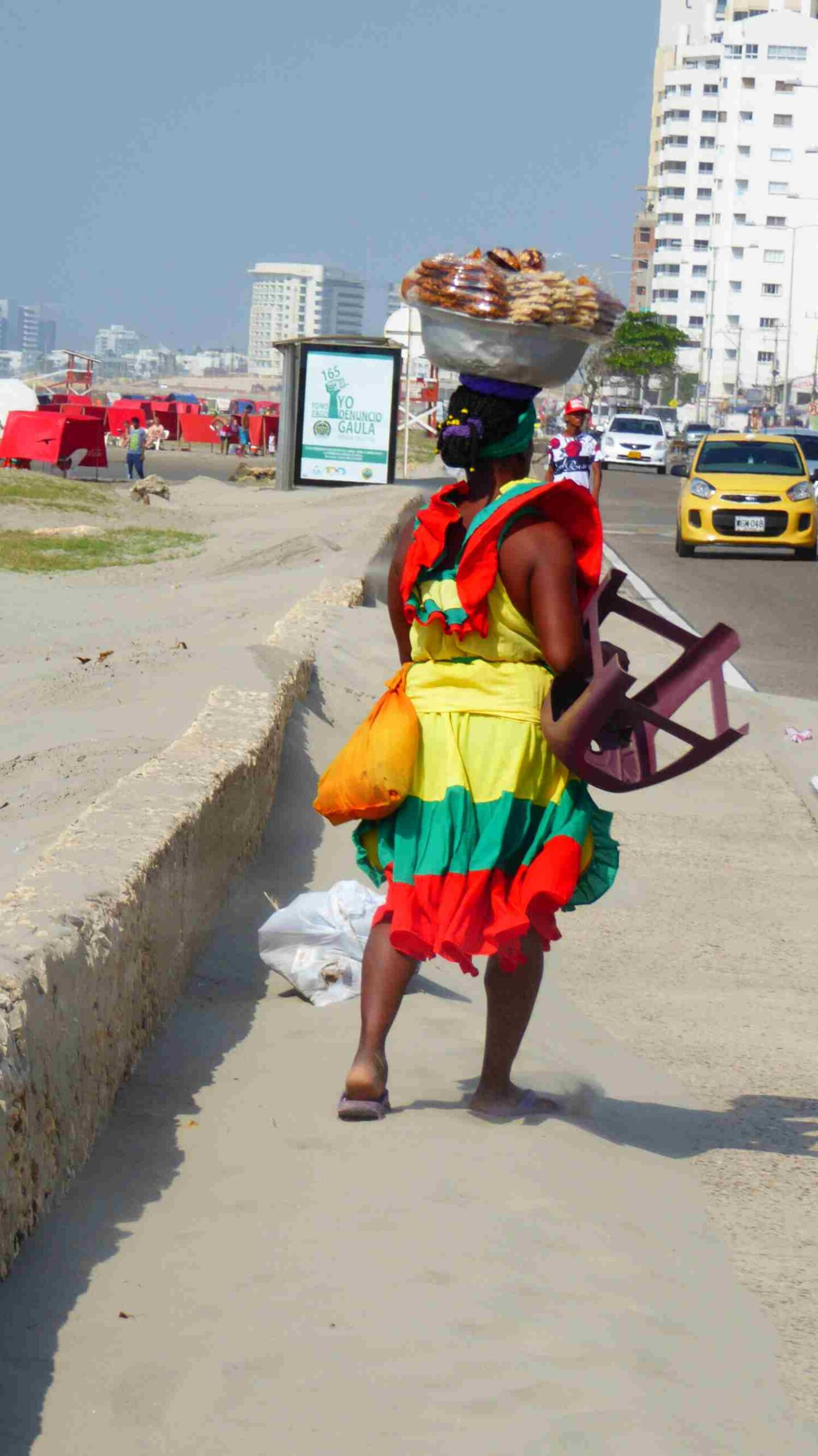 a colorful lady at the beach in Cartagena